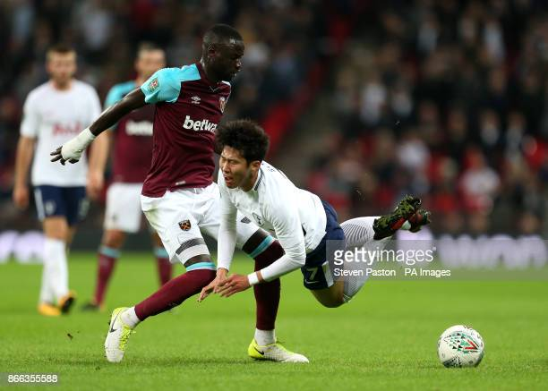 West Ham United's Cheikhou Kouyate and Tottenham Hotspur's Son HeungMin battle for the ball during the Carabao Cup Fourth Round match at Wembley...