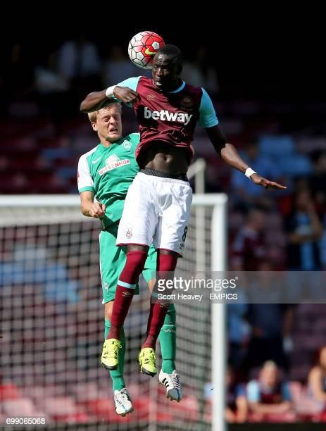 West Ham United's Cheikhou Kouyate and Werder Bremen's Felix Kroos