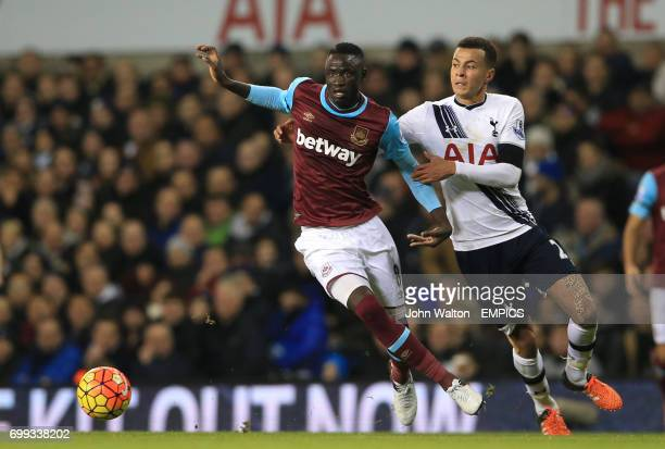 West Ham United's Cheikhou Kouyate battles for possession of the ball with Tottenham Hotspur's Dele Alli