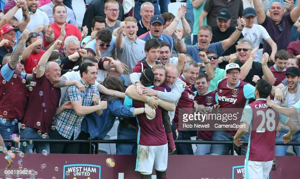 West Ham United's Cheikhou Kouyate celebrates scoring his sides first goal with the West Ham fans during the Premier League match between West Ham...