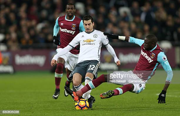West Ham United's Cheikhou Kouyate challenges Manchester United's Henrikh Mkhitaryan during the Premier League match between West Ham United and...