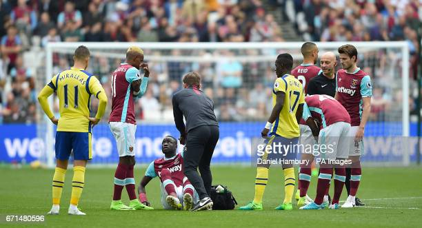 West Ham United's Cheikhou Kouyate receives medical attention after a challenge during the Premier League match at London Stadium