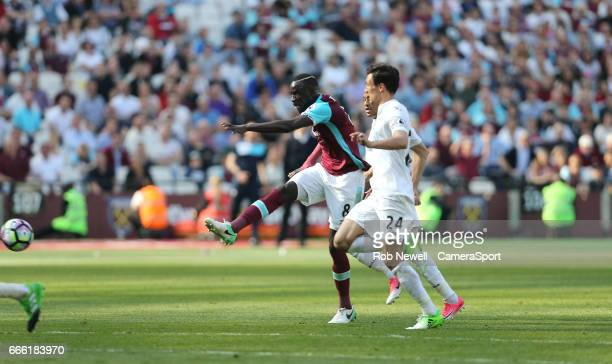 West Ham United's Cheikhou Kouyate scores his sides first goal during the Premier League match between West Ham United and Swansea City at London...