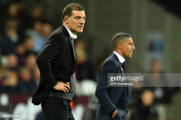 West Ham United's Croatian manager Slaven Bilic and Brighton's Irish manager Chris Hughton watch from the touchline during the English Premier League...