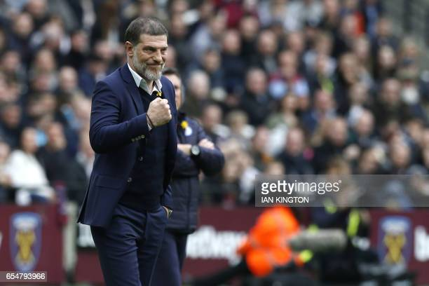 West Ham United's Croatian manager Slaven Bilic celebrates his teams first goal during the English Premier League football match between West Ham...
