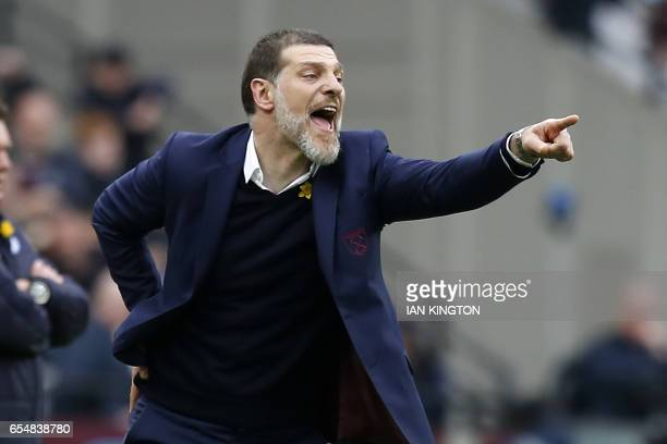 West Ham United's Croatian manager Slaven Bilic gestures on the touchline during the English Premier League football match between West Ham United...