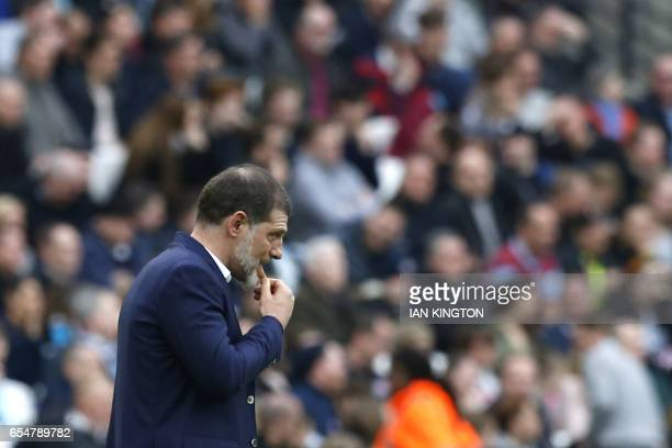 West Ham United's Croatian manager Slaven Bilic reacts after Leicester scored their second goal during the English Premier League football match...