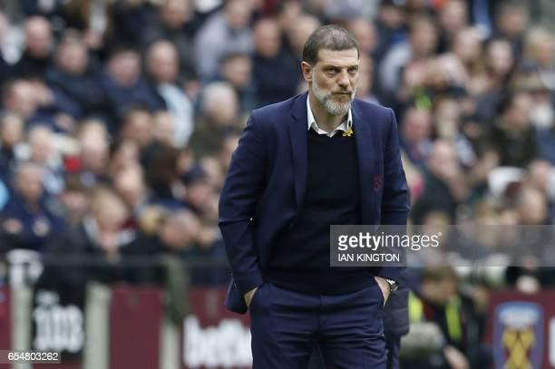 West Ham United's Croatian manager Slaven Bilic reacts during the English Premier League football match between West Ham United and Leicester City at...