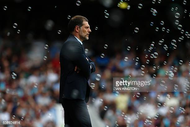 TOPSHOT West Ham United's Croatian manager Slaven Bilic watches during the English Premier League football match between West Ham United and Swansea...