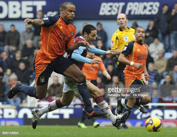West Ham United's David Di Michele and Manchester City's Vincent Kompany bbattle for the ball