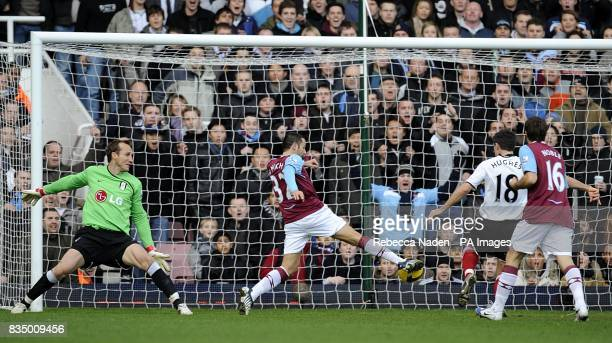 West Ham United's David Di Michele takes the ball past Fulham goalkeeper Mark Schwarzer to score the opening goal of the game
