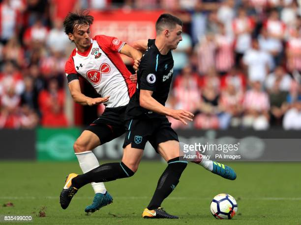 West Ham United's Declan Rice and Southampton's Manolo Gabbiadini battle for the ball during the Premier League match at St Mary's Southampton