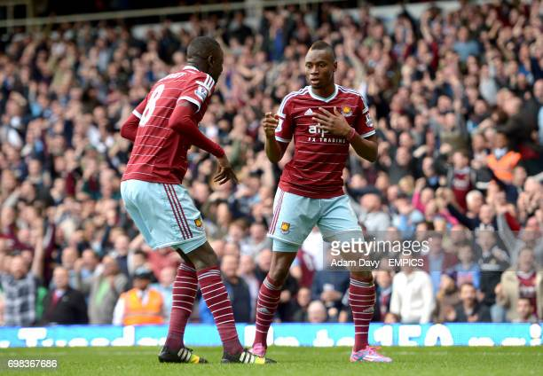 West Ham United's Diafra Sakho celebrates scoring his side's second goal of the game with teammate Cheikhou Kouyate