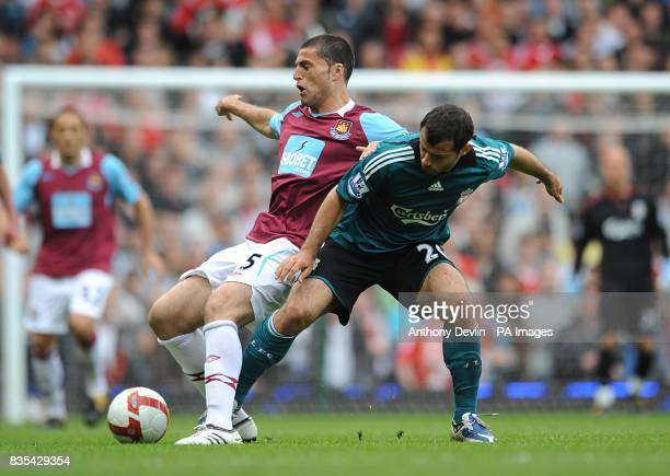 West Ham United's Diego Tristan and Liverpool's Javier Mascherano battle for the ball