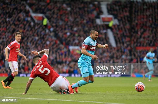 West Ham United's Dimitri Payet goes down in the box under a challenge from Manchester United's Marcos Rojo but is not awarded a penalty