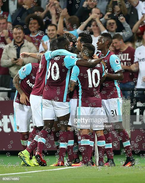 West Ham United's Dimitri Payet is congratulated after scoring his sides first goal during the EFL Cup Third Round match between West Ham United and...