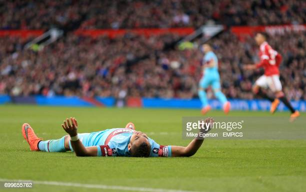 West Ham United's Dimitri Payet is left dejected after going down in the box under a challenge from Manchester United's Marcos Rojo but not awarded a...