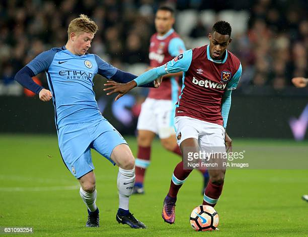 West Ham United's Edimilson Fernandes and Manchester City's Kevin De Bruyne battle for the ball during the Emirates FA Cup Third Round match at the...
