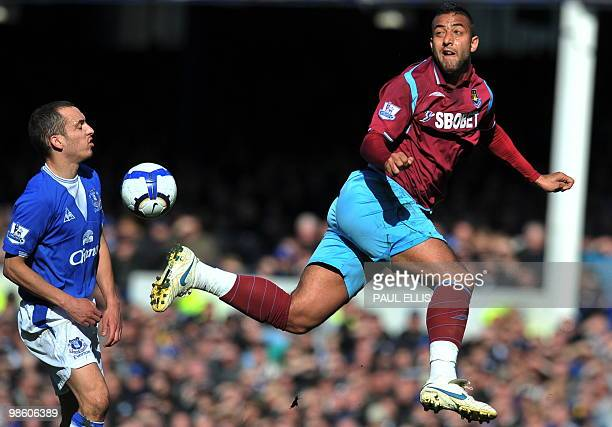 West Ham United's Egyptian forward Mido gets the ball past Everton's English midfielder Leon Osman during their English Premier League football match...