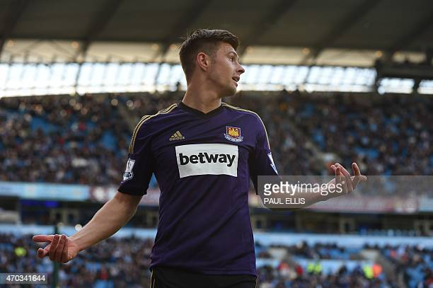 West Ham United's English defender Aaron Cresswell reacts after missing a chance during the English Premier League football match between Manchester...