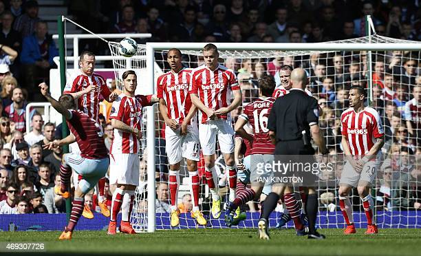 West Ham United's English defender Aaron Cresswell scores from this free kick during the English Premier League football match between West Ham...