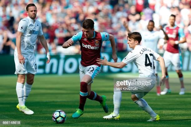 West Ham United's English defender Sam Byram goes past Swansea City's English midfielder Tom Carroll during the English Premier League football match...