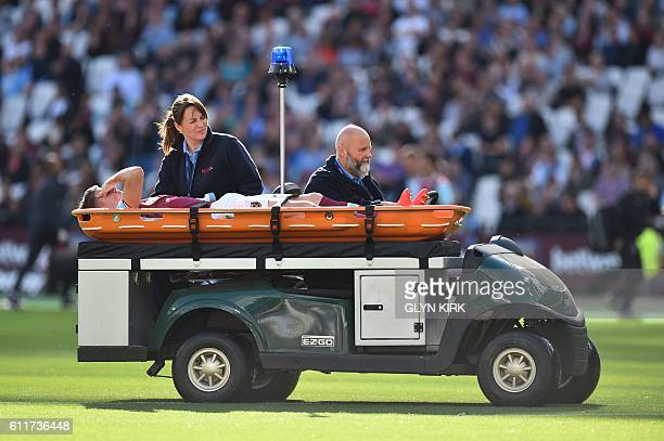 TOPSHOT West Ham United's English defender Sam Byram is stretchered off the field injured during the English Premier League football match between...
