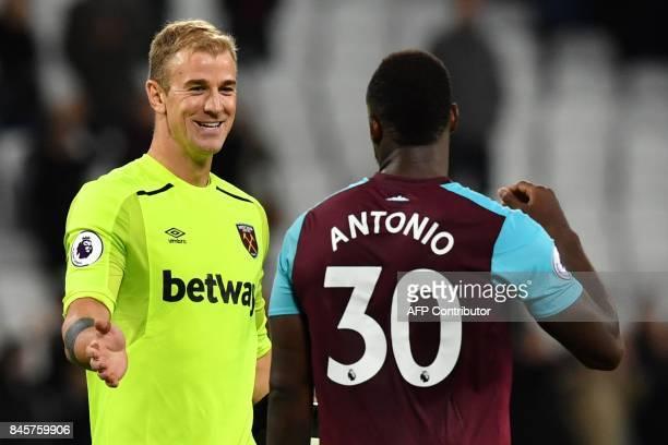 West Ham United's English goalkeeper Joe Hart and West Ham United's English midfielder Michail Antonio celebrate after the English Premier League...