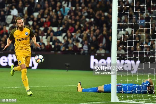 West Ham United's English goalkeeper Joe Hart reacts as Brighton's English striker Glenn Murray celebrates after scoring their third goal from the...