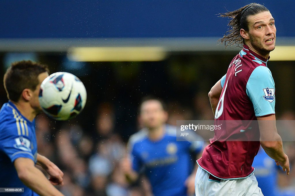 """West Ham United's English midfielder Andy Carroll (R) jumps for the ball during the English Premier League football match between Chelsea and West Ham United at Stamford Bridge in London on March 17, 2013. USE. No use with unauthorized audio, video, data, fixture lists, club/league logos or """"live"""" services. Online in-match use limited to 45 images, no video emulation. No use in betting, games or single club/league/player publications."""