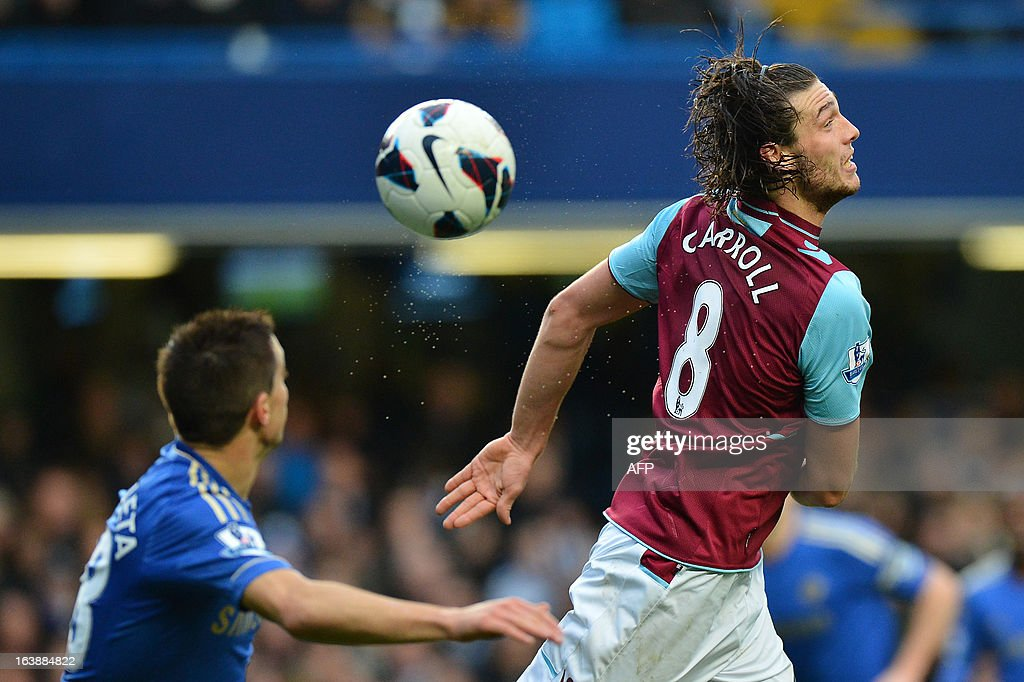 "West Ham United's English midfielder Andy Carroll (R) jumps for the ball during the English Premier League football match between Chelsea and West Ham United at Stamford Bridge in London on March 17, 2013. USE. No use with unauthorized audio, video, data, fixture lists, club/league logos or ""live"" services. Online in-match use limited to 45 images, no video emulation. No use in betting, games or single club/league/player publications."