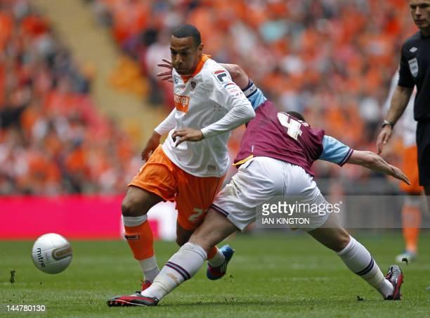 West Ham United's English midfielder Kevin Nolan vies with Blackpool's English midfielder Matt Phillips during the 2012 Championship playoff final...