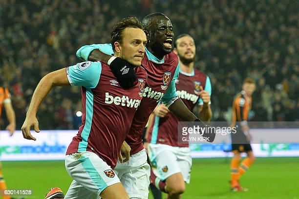 West Ham United's English midfielder Mark Noble celebrates with West Ham United's Senegalese midfielder Cheikhou Kouyate after scoring the opening...