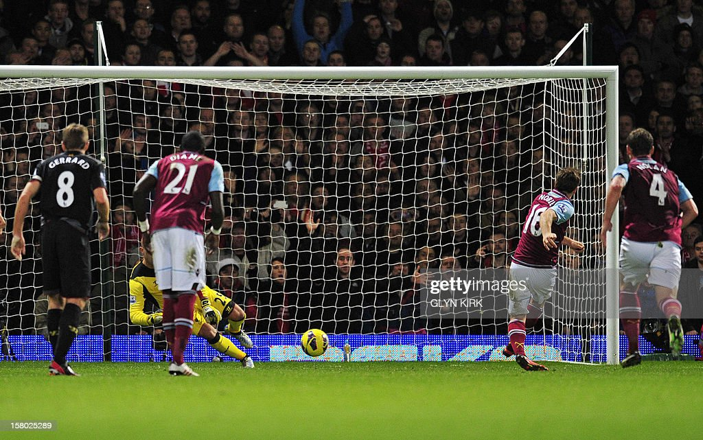 "West Ham United's English midfielder Mark Noble (2nd R) scores their first goal from the penalty spot during the English Premier League football match between West Ham United and Liverpool at the Boleyn Ground, Upton Park, in East London, England, on December 9, 2012. USE. No use with unauthorized audio, video, data, fixture lists, club/league logos or ""live"" services. Online in-match use limited to 45 images, no video emulation. No use in betting, games or single club/league/player publications"