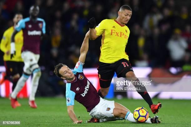 West Ham United's English midfielder Mark Noble slides in on Watford's Brazilian striker Richarlison de Andrade during the English Premier League...