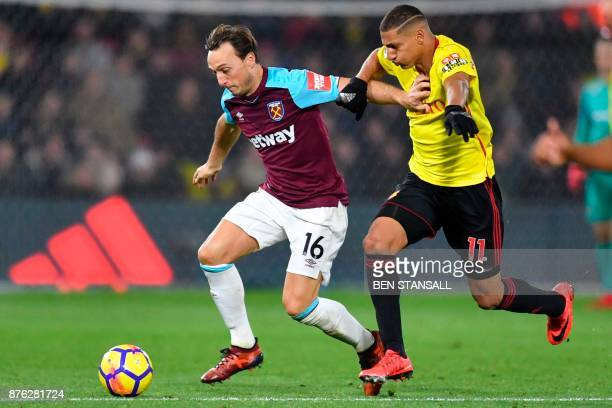 West Ham United's English midfielder Mark Noble tangles with Watford's Brazilian striker Richarlison de Andrade during the English Premier League...