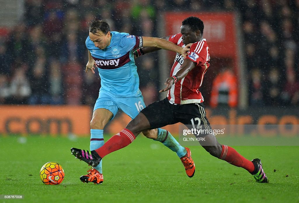 West Ham United's English midfielder Mark Noble (L) vies with Southampton's Kenyan midfielder Victor Wanyama during the English Premier League football match between Southampton and West Ham United at St Mary's Stadium in Southampton, southern England on February 6, 2016. / AFP / GLYN KIRK / RESTRICTED TO EDITORIAL USE. No use with unauthorized audio, video, data, fixture lists, club/league logos or 'live' services. Online in-match use limited to 75 images, no video emulation. No use in betting, games or single club/league/player publications. /