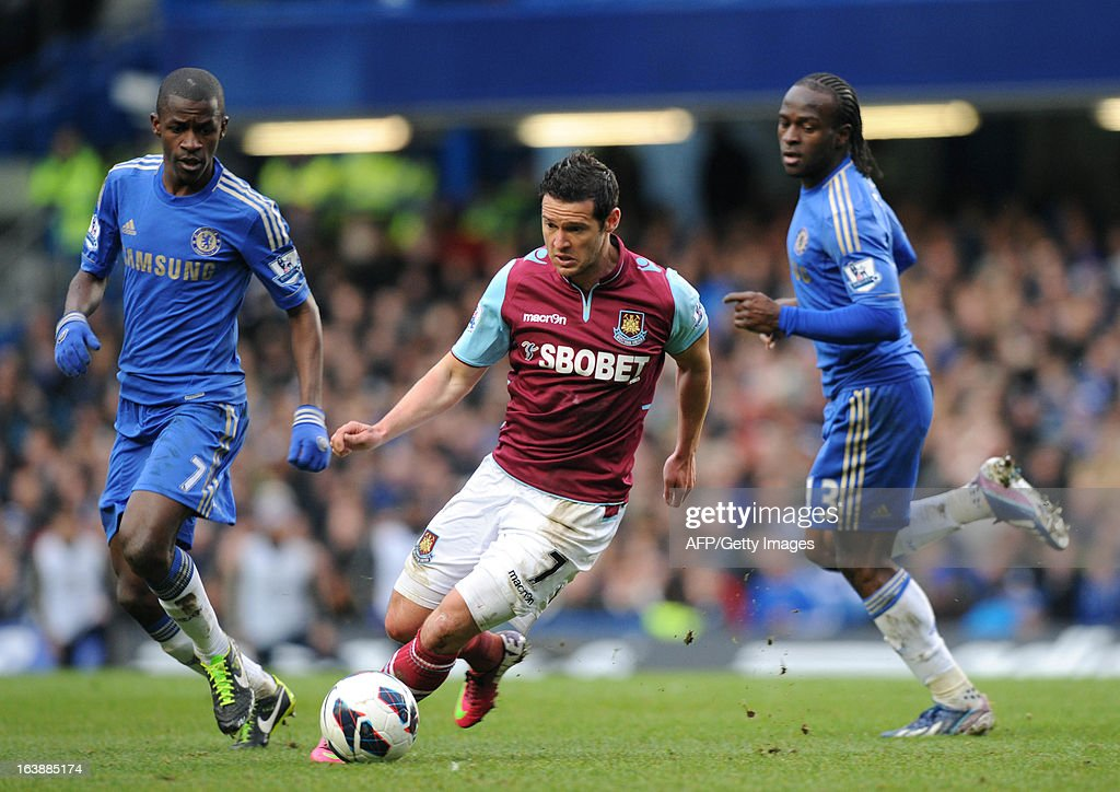 "West Ham United's English midfielder Matt Jarvis (C) dribbles the ball flanked by Chelsea's Brazilian midfielder Ramierez (L) and Nigerian midfielder Victor Moses (R) during the English Premier League football match between Chelsea and West Ham United at Stamford Bridge in London on March 17, 2013. USE. No use with unauthorized audio, video, data, fixture lists, club/league logos or ""live"" services. Online in-match use limited to 45 images, no video emulation. No use in betting, games or single club/league/player publications."