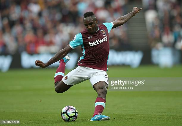West Ham United's English midfielder Michail Antonio attempts a shot on goal during the English Premier League football match between West Ham United...