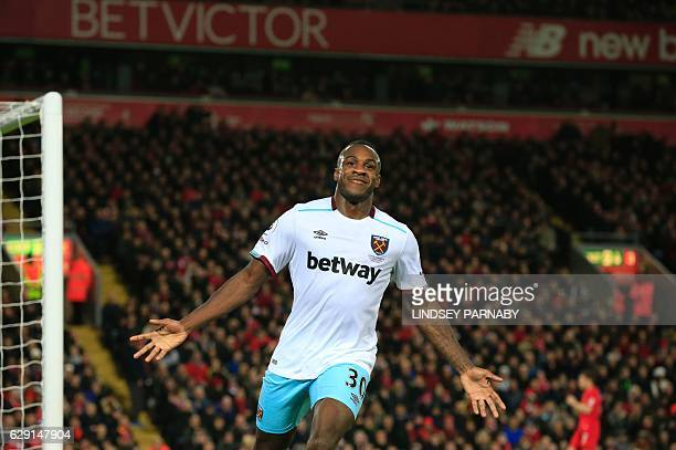 West Ham United's English midfielder Michail Antonio celebrates scoring their second goal during the English Premier League football match between...