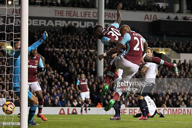 West Ham United's English midfielder Michail Antonio heads the ball past Tottenham Hotspur's French goalkeeper Hugo Lloris for the opening goal of...