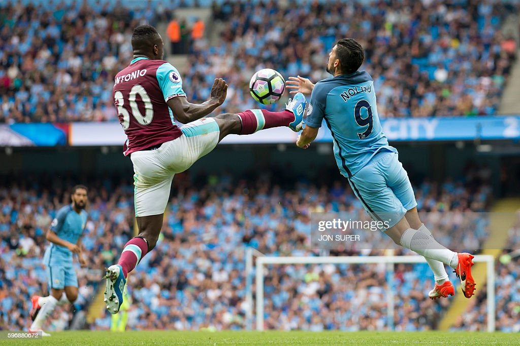 TOPSHOT - West Ham United's English midfielder Michail Antonio (L) vies with Manchester City's Spanish midfielder Nolito during the English Premier League football match between Manchester City and West Ham United at the Etihad Stadium in Manchester, north west England, on August 28, 2016. / AFP / JON SUPER / RESTRICTED TO EDITORIAL USE. No use with unauthorized audio, video, data, fixture lists, club/league logos or 'live' services. Online in-match use limited to 75 images, no video emulation. No use in betting, games or single club/league/player publications. /