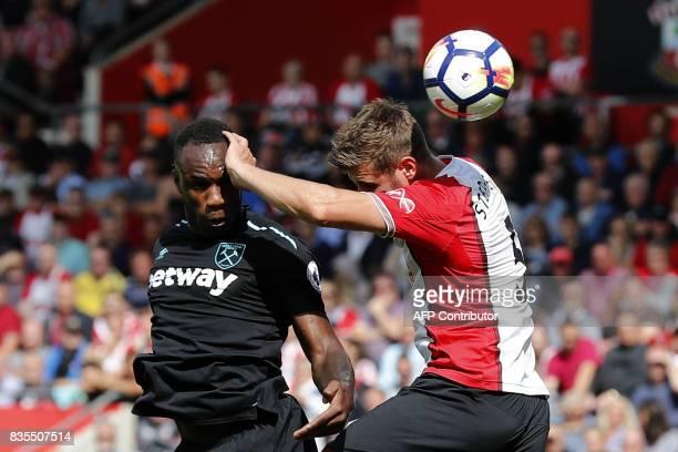 West Ham United's English midfielder Michail Antonio vies with Southampton's English defender Jack Stephens during the English Premier League...