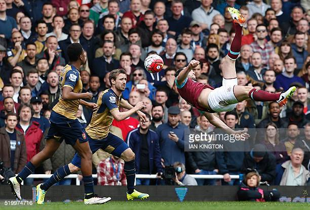 West Ham United's English striker Andy Carroll attempts an overhead shot on goal during the English Premier League football match between West Ham...