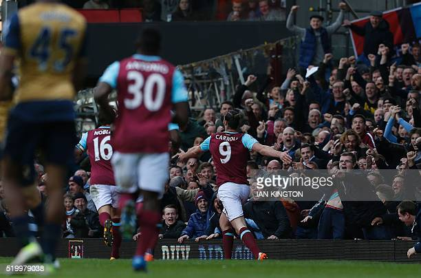 West Ham United's English striker Andy Carroll celebrates scoring his team's third goal his hat trick during the English Premier League football...