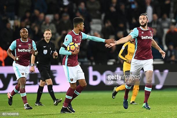 West Ham United's English striker Andy Carroll celebrates with West Ham United's English striker Ashley Fletcher after scoring their first goal...