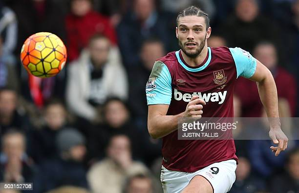 West Ham United's English striker Andy Carroll chases the ball during the English Premier League football match between West Ham United and Liverpool...