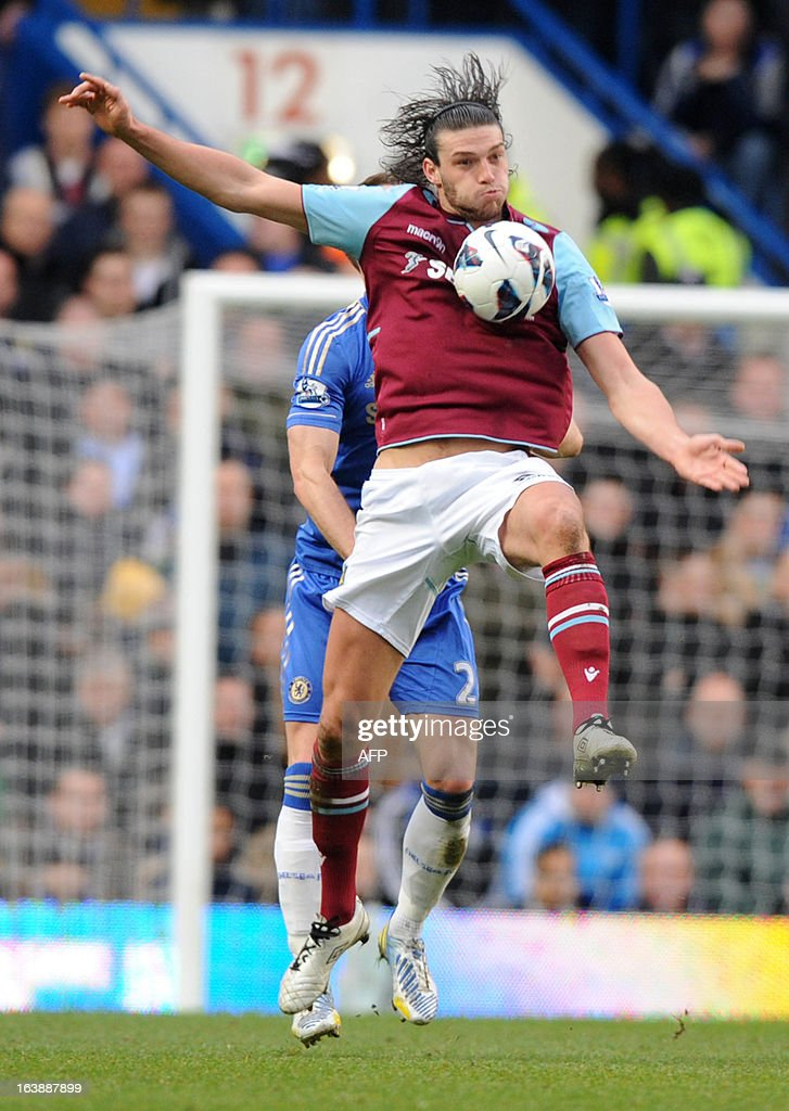 """West Ham United's English striker Andy Carroll controls the ball during the English Premier League football match between Chelsea and West Ham United at Stamford Bridge in London on March 17, 2013. USE. No use with unauthorized audio, video, data, fixture lists, club/league logos or """"live"""" services. Online in-match use limited to 45 images, no video emulation. No use in betting, games or single club/league/player publications."""