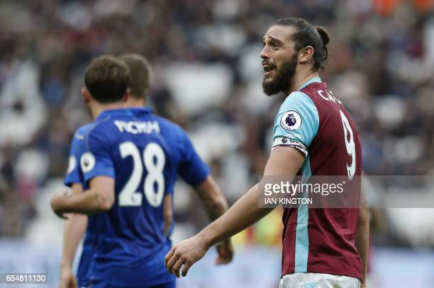 West Ham United's English striker Andy Carroll reacts during the English Premier League football match between West Ham United and Leicester City at...