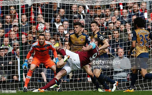 West Ham United's English striker Andy Carroll shoots to score his team's second goal during the English Premier League football match between West...